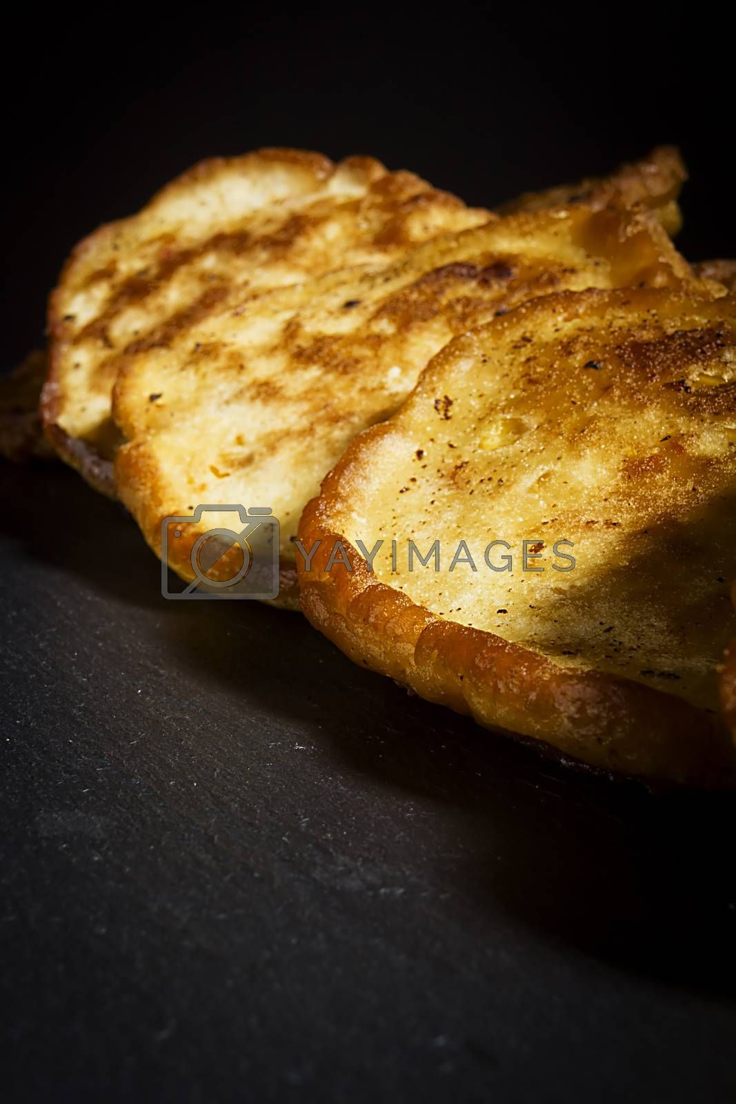 Fresh pancakes with corn on a wooden board