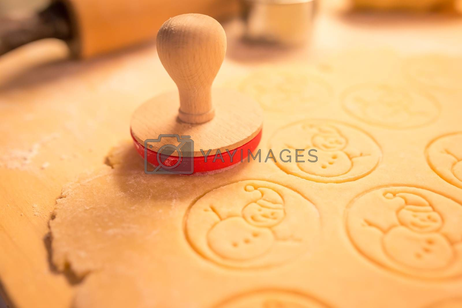 Royalty free image of Christmas cookies bakery with raw biscuit dough and cutters with christmas theme shape - Christmas theme dough stamp, Snowman. by petrsvoboda91
