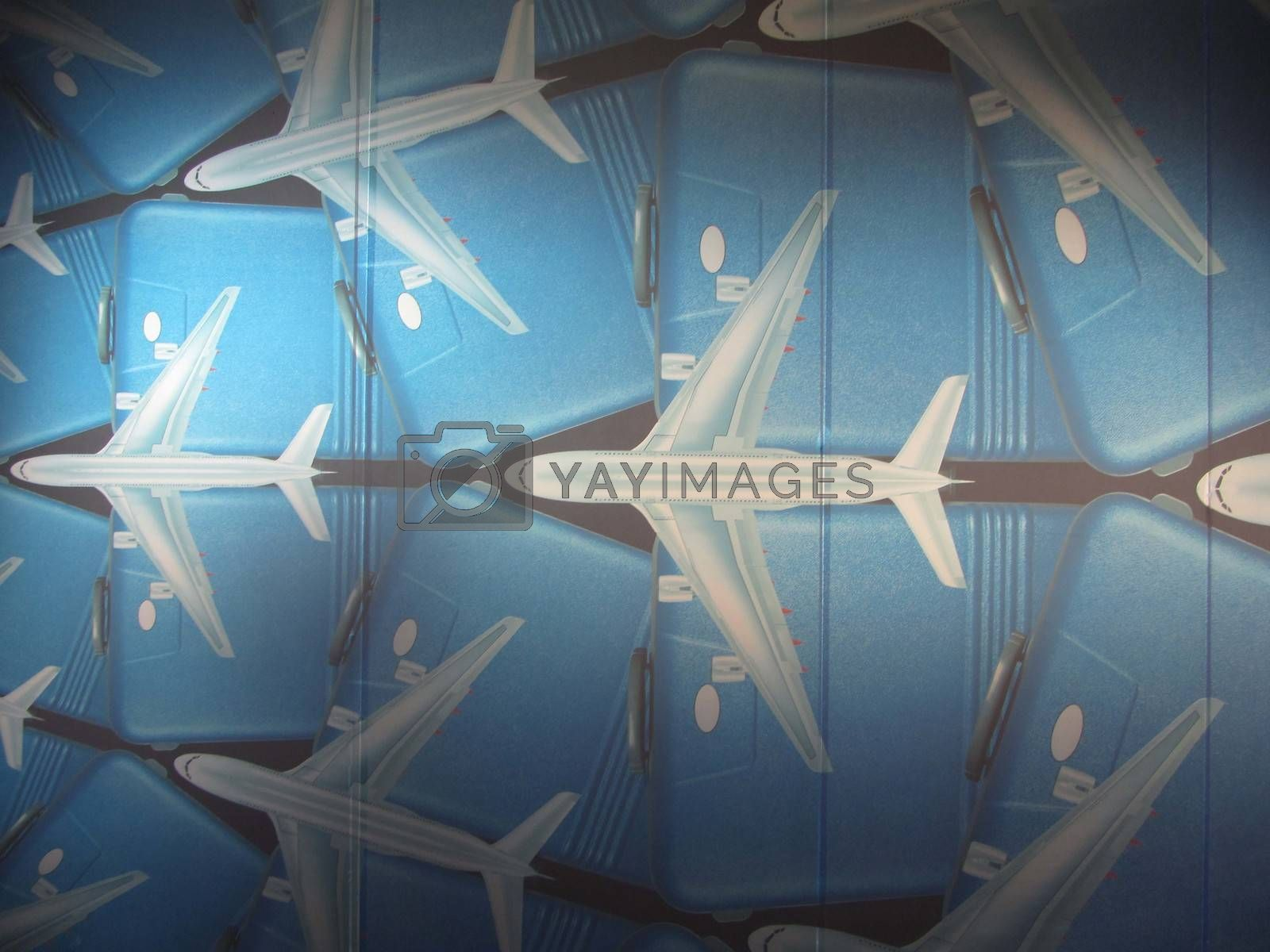 white airplanes and blue suitcases as a symbol for traveling