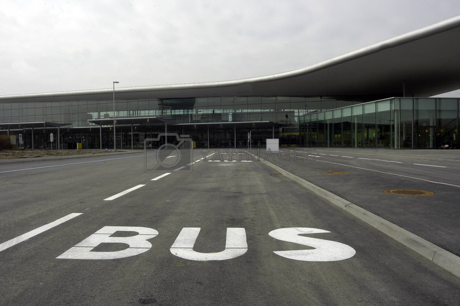 white bus lane mark on the street in front of an airport