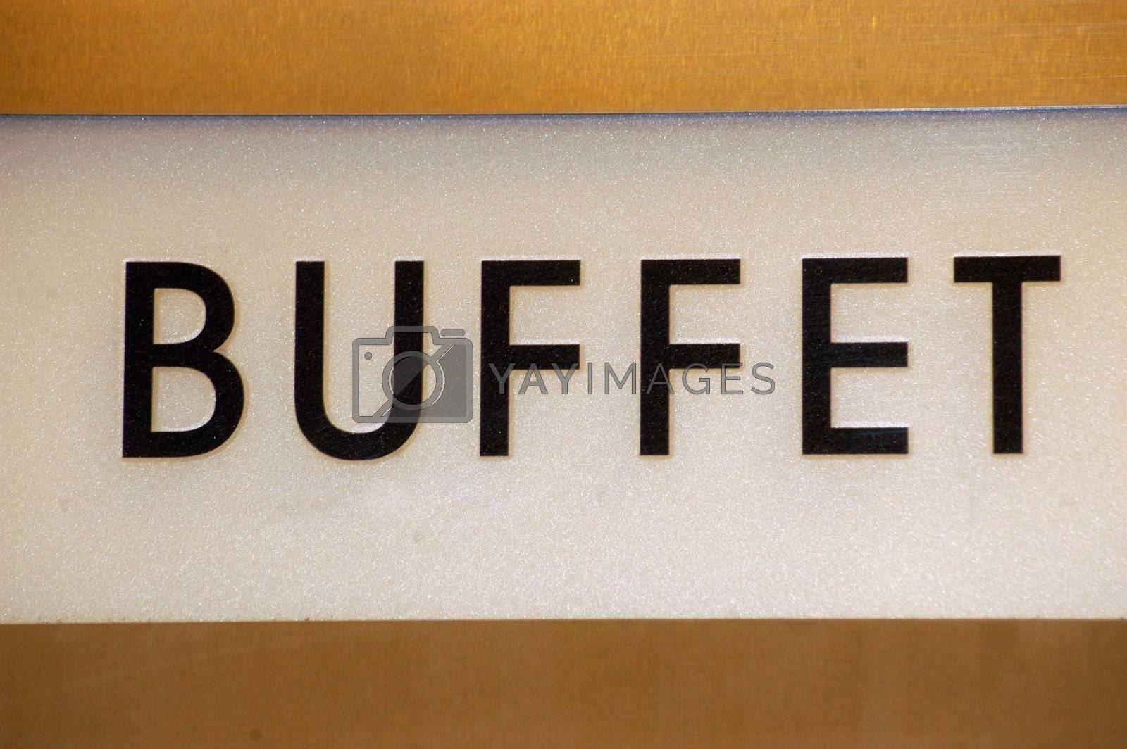 a black Buffet sign with white background on a wall