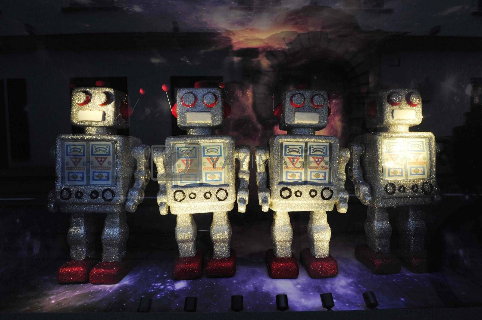 four robot toy figures standing on a dark space background