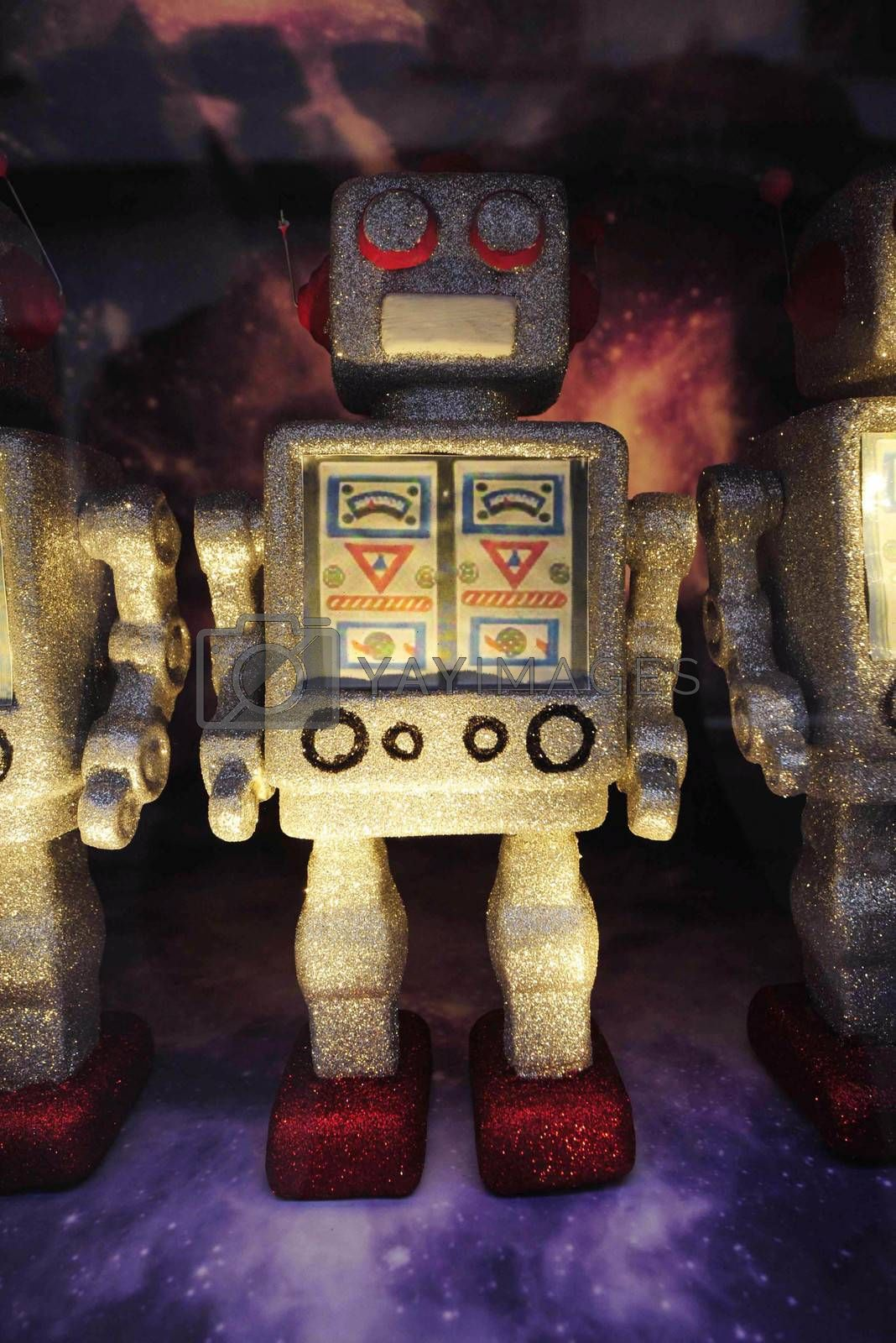 a robot toy figures standing on a dark space background