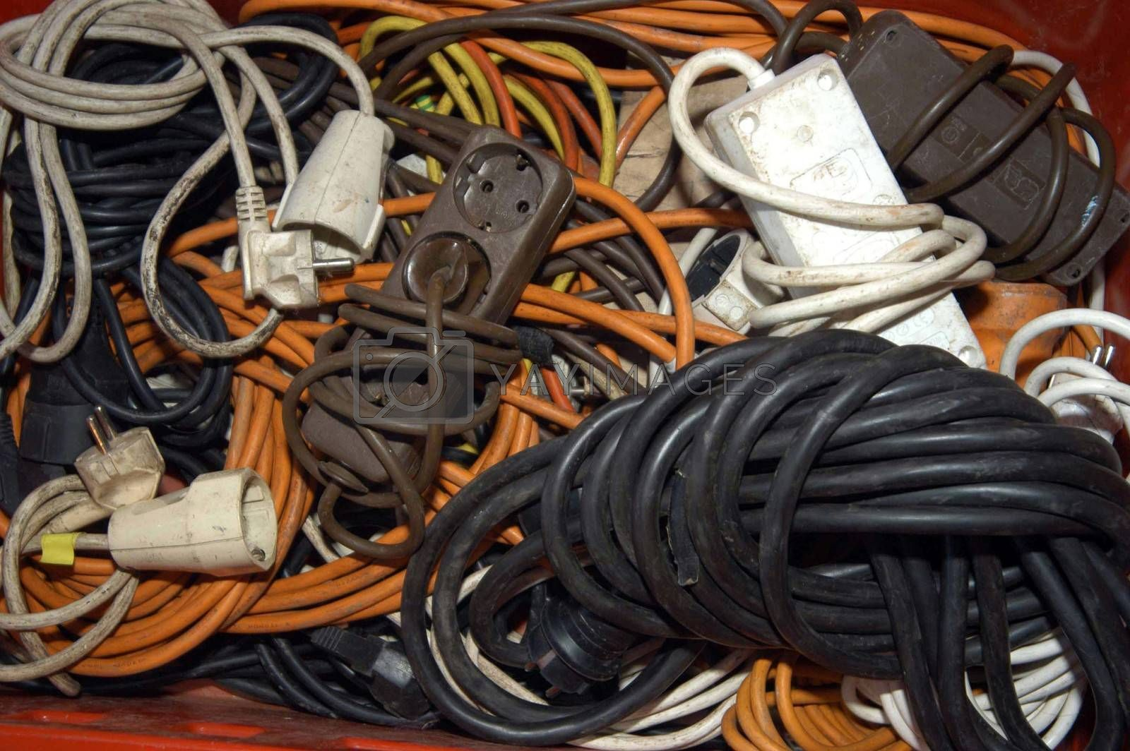 Various multi socket adapters and extension cables stored in a box