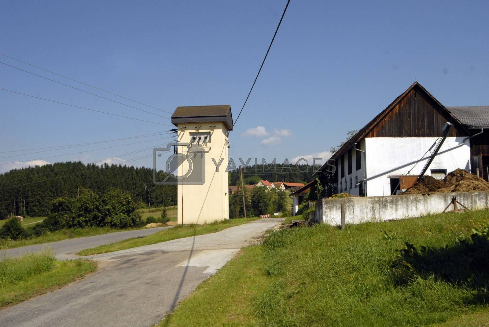 an electrical substation next to the street in the countryside