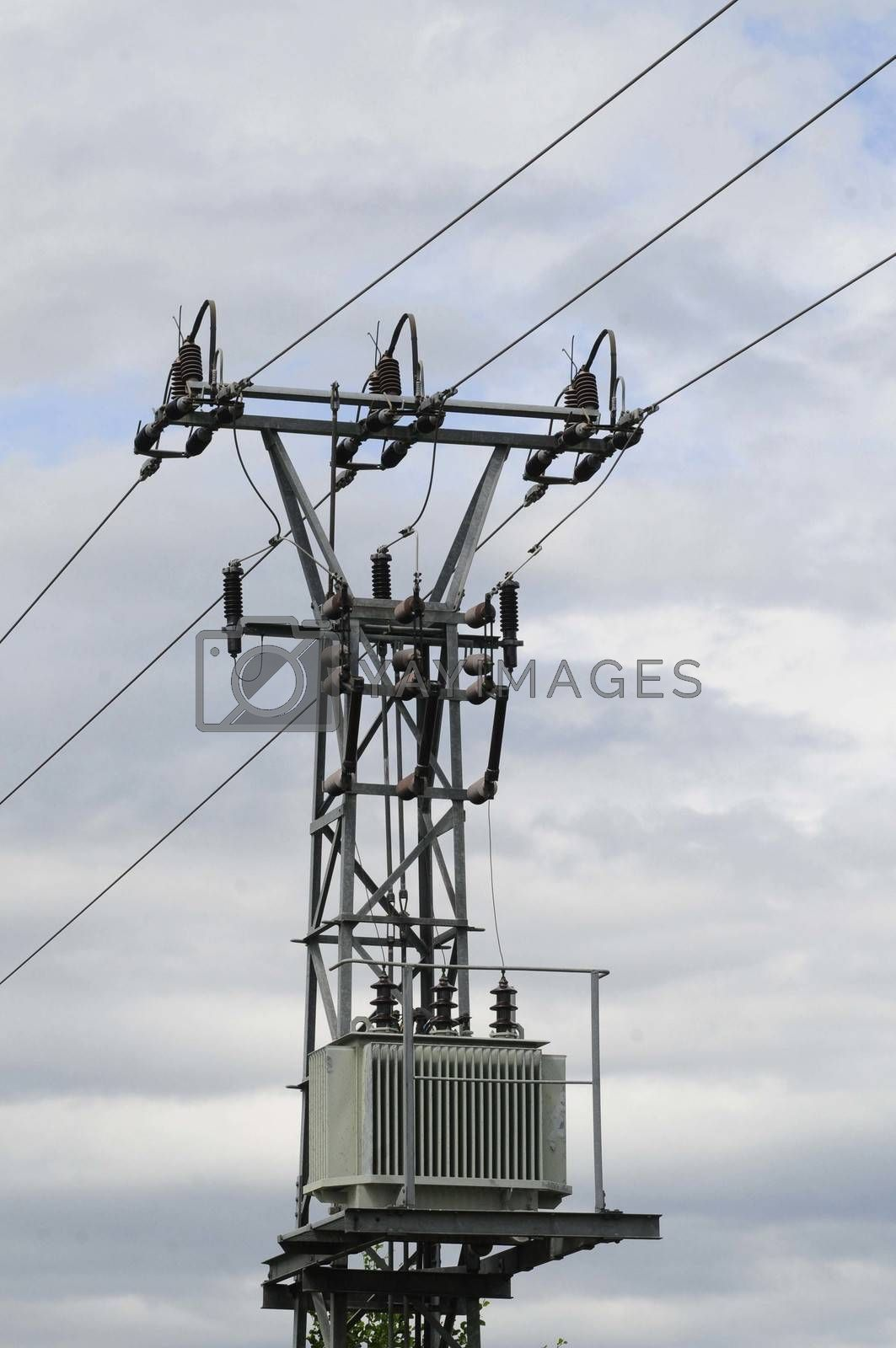 an electricity Transformer with a cloudy sky in the background