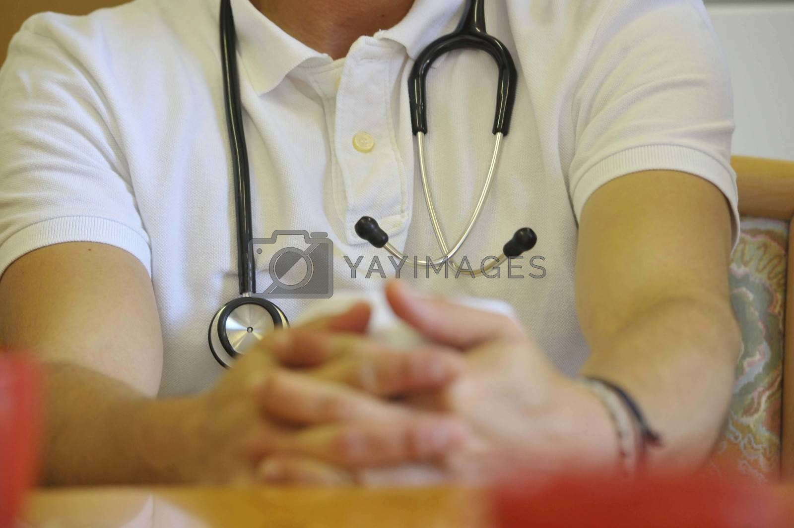doctor in white shirt wearing a stethoscope around his neck