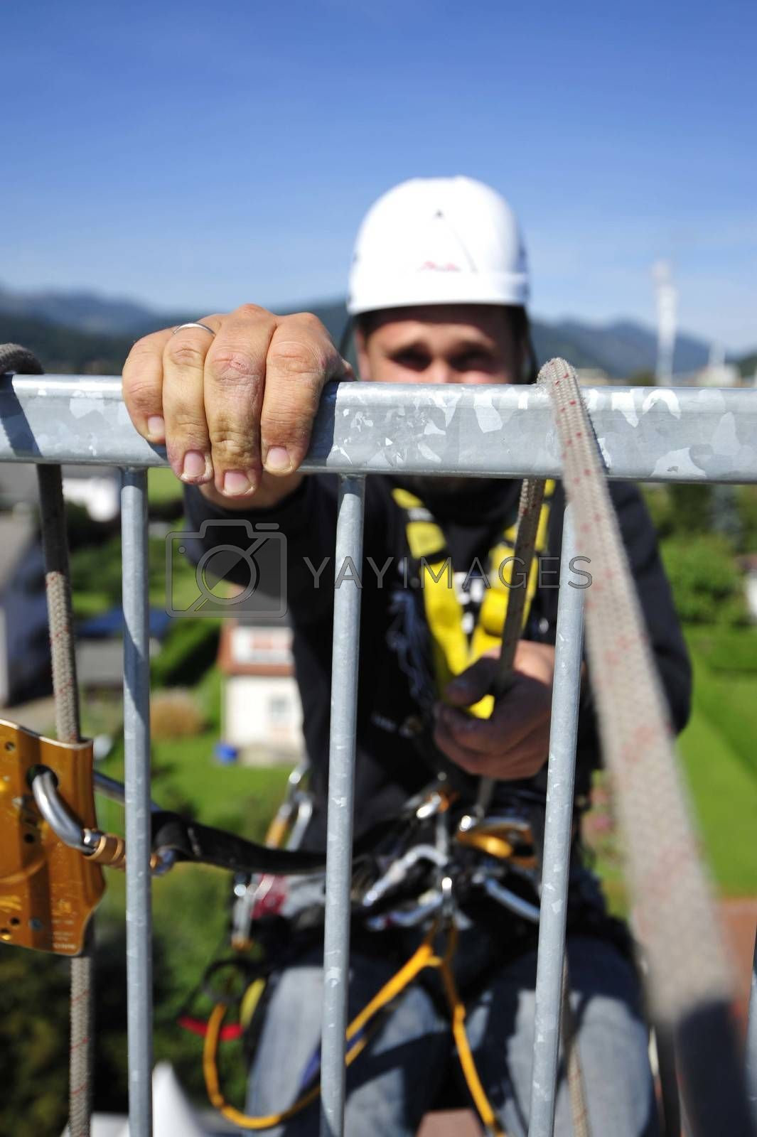 man with safety equipment at training as a height worker