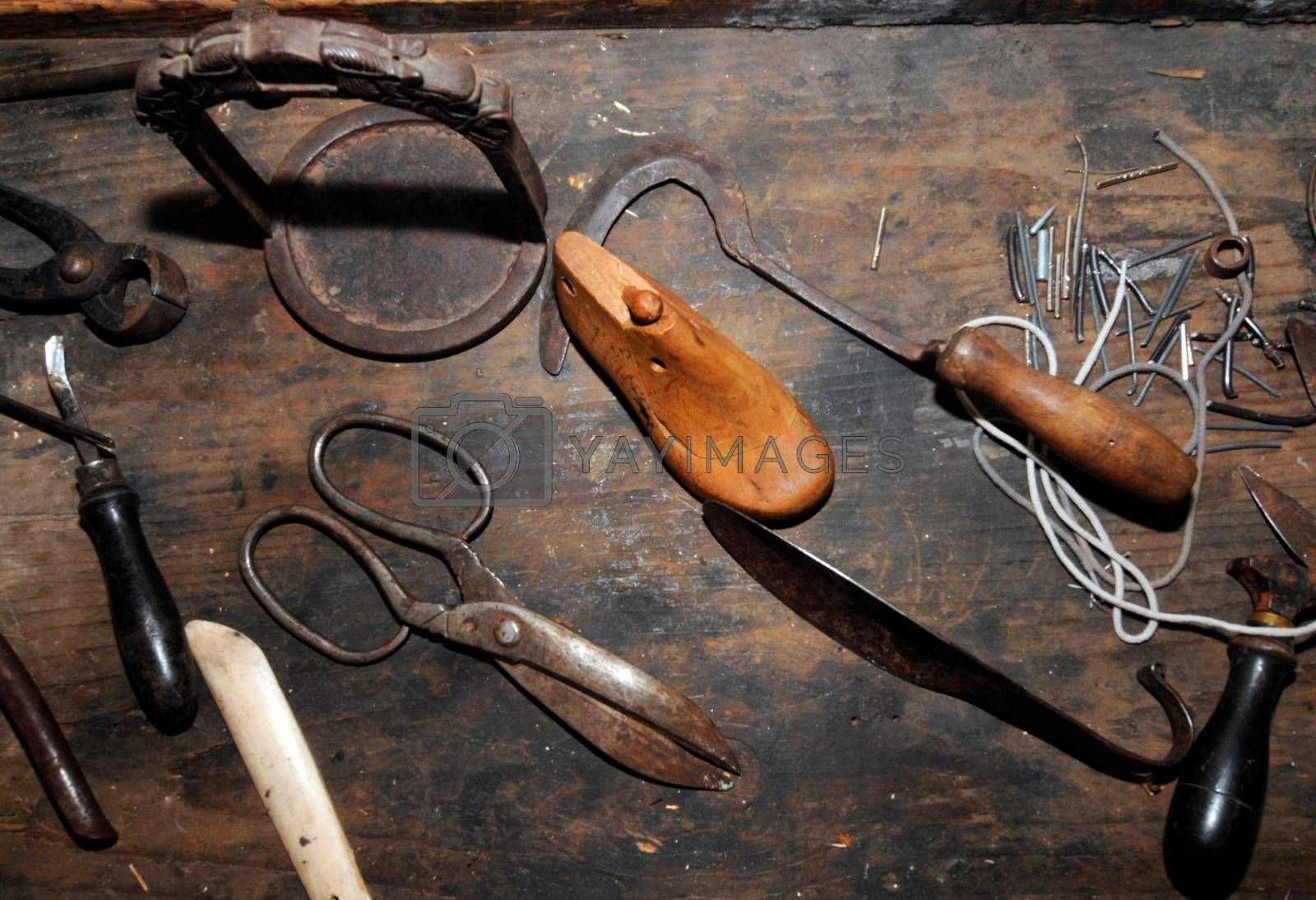 at a shoemakers workshop, table with old and used tools