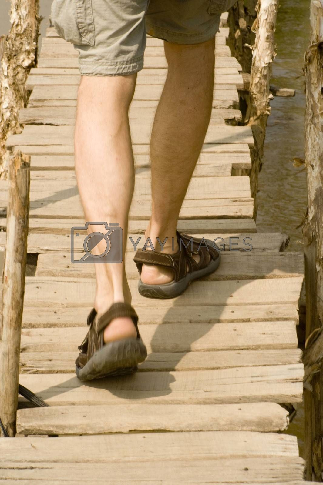 a person wearing sandals on a sunny summer day, outdoors