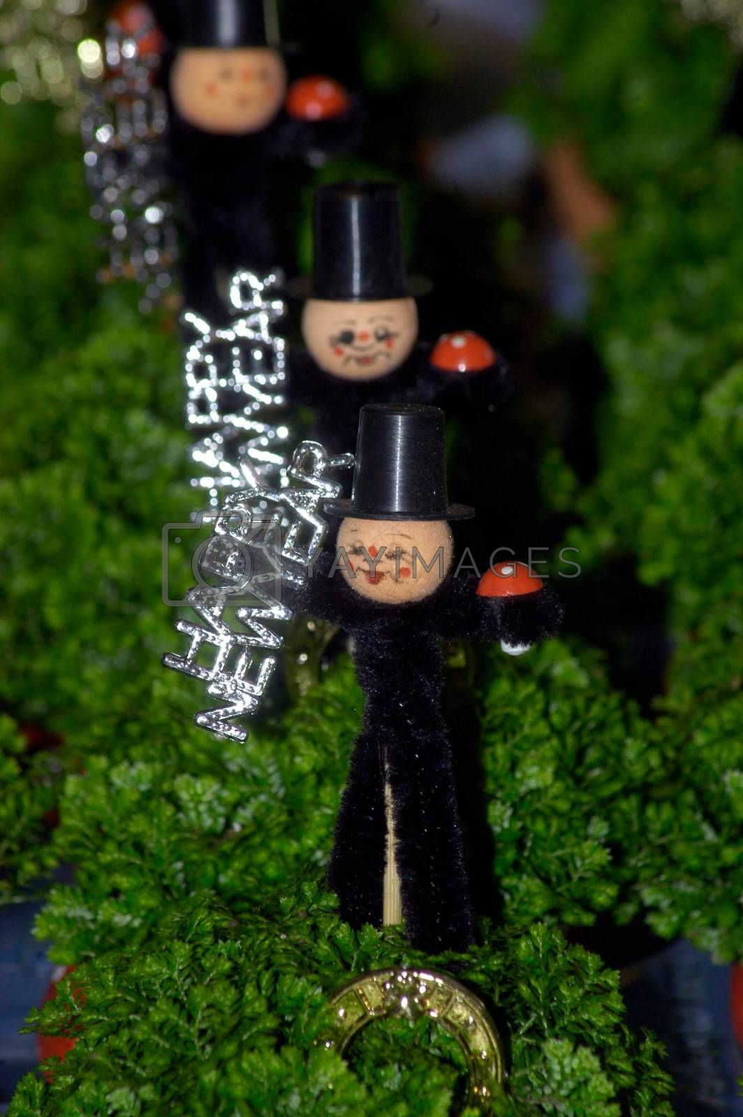 chimney sweep as a good luck charm on green decoration with Happy New Year sign
