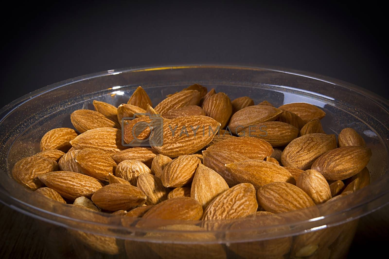 Dried almonds in plastic packaging close up
