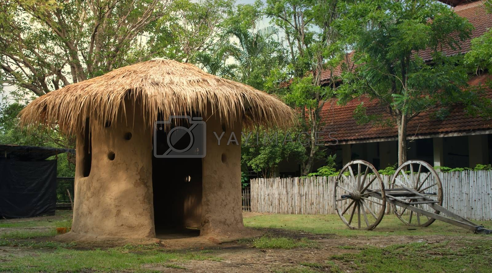 A small thatched-roof mud house common in Thailand.