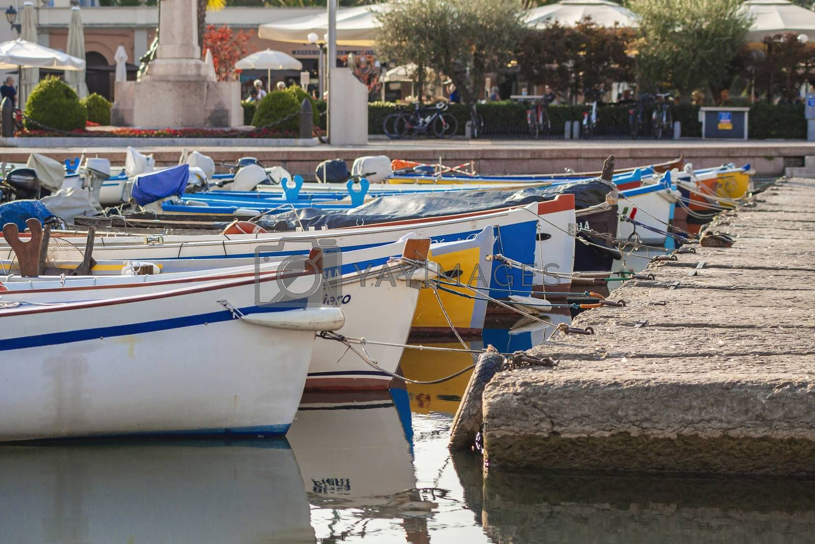Colored boats moored on Bardolino port in Italy 2 by pippocarlot