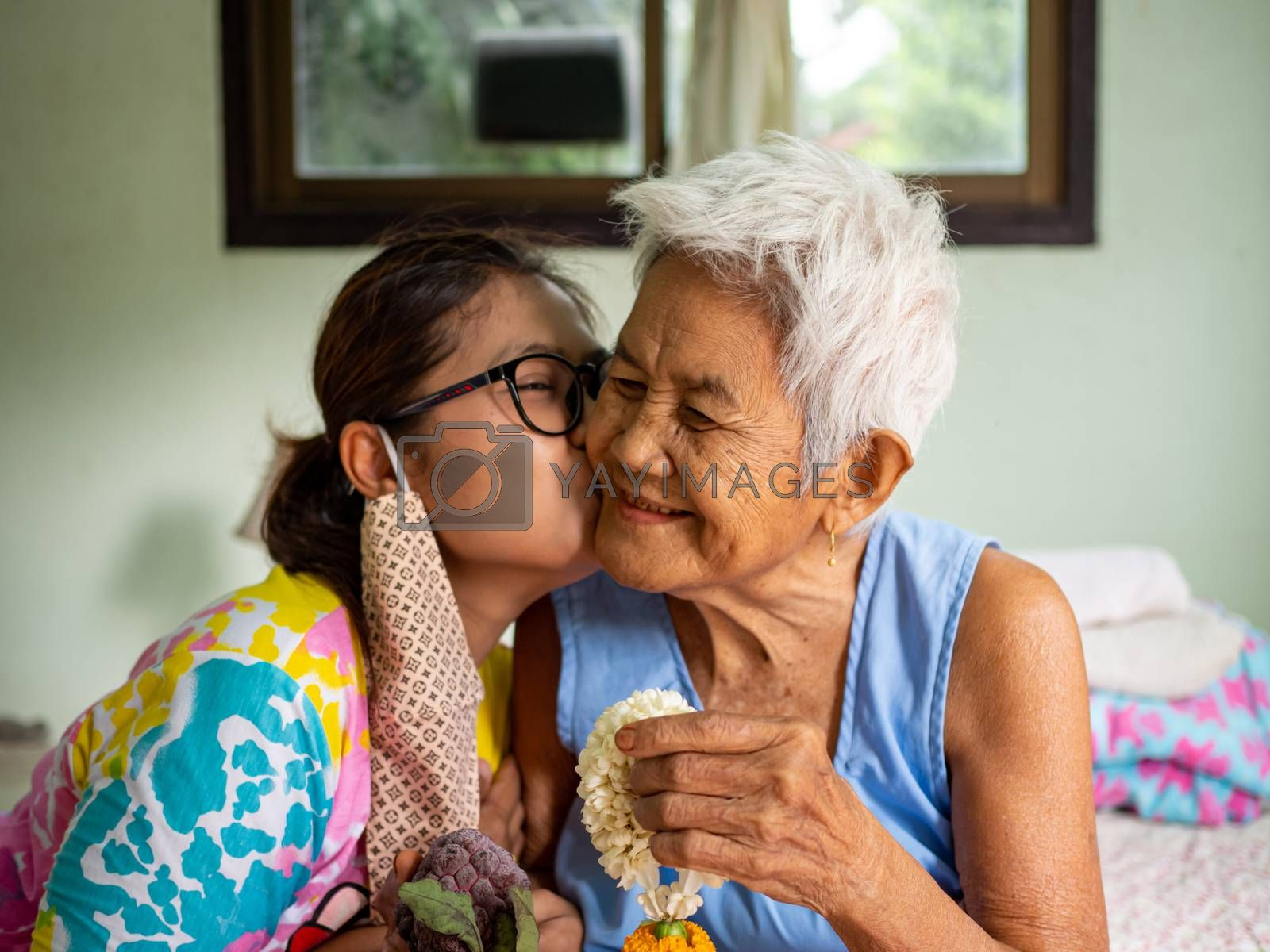 The image of the woman on the cheek grandmother. real bodies concept.