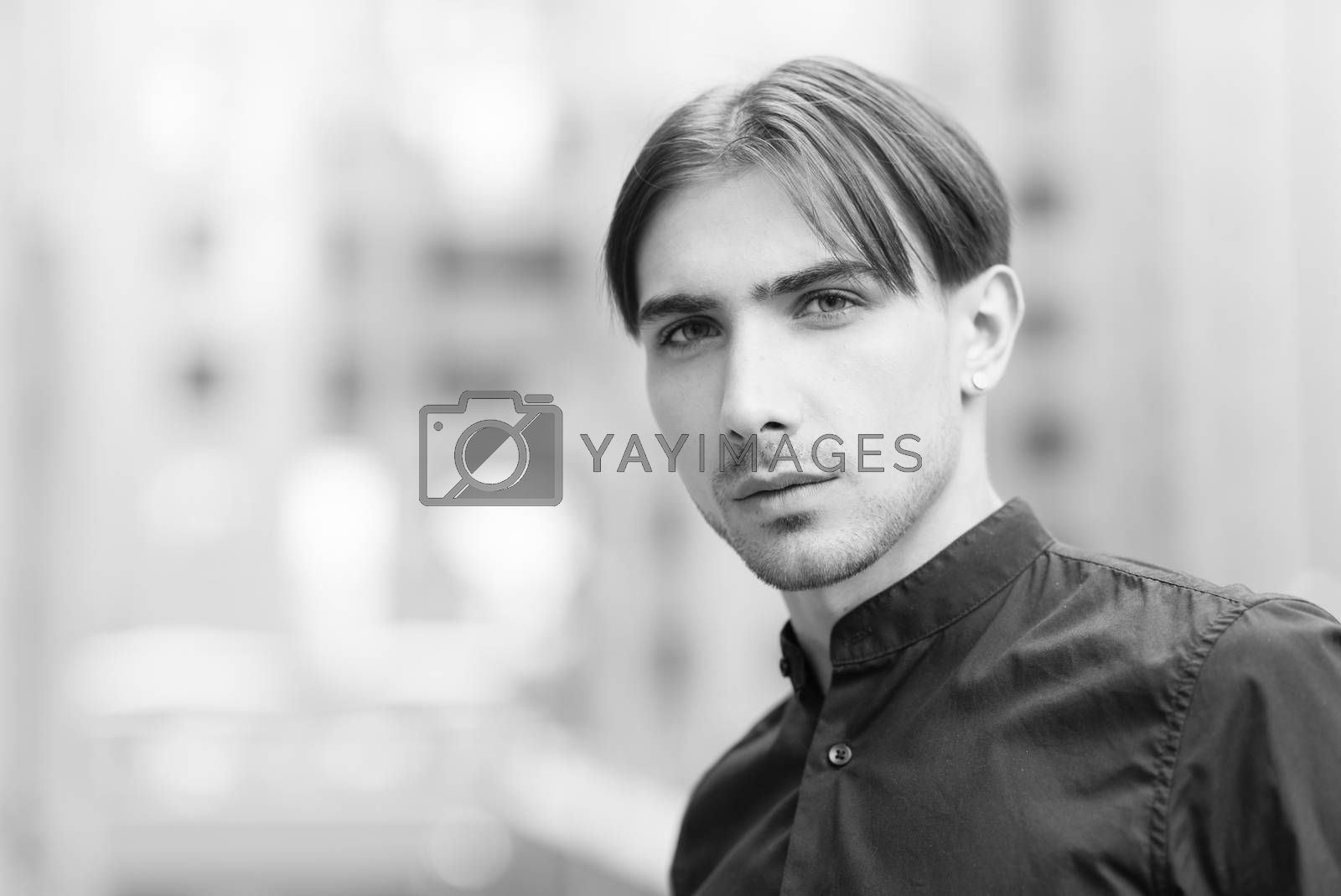 Portrait of a gay man - member of the LGBTQ community by day. Black and white photo. BW