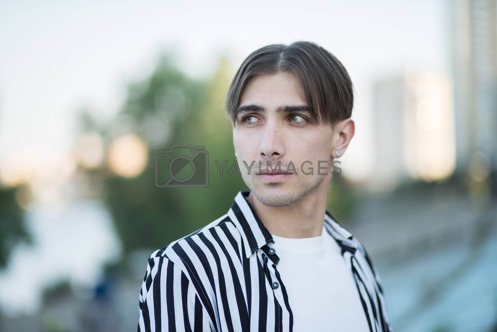 Portrait of a gay man - member of the LGBTQ community by day