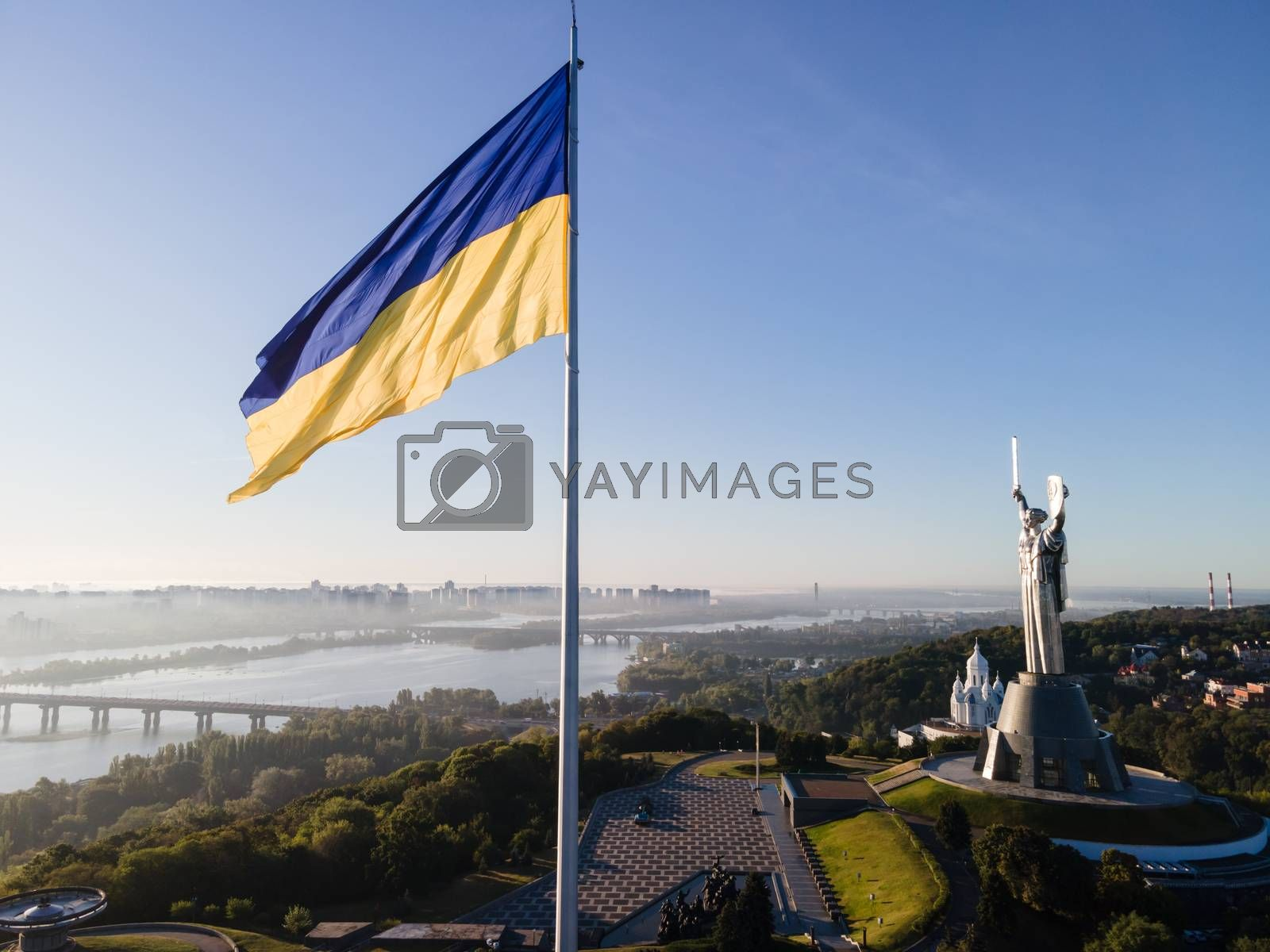 Kyiv - National flag of Ukraine by day. Aerial. Kiev