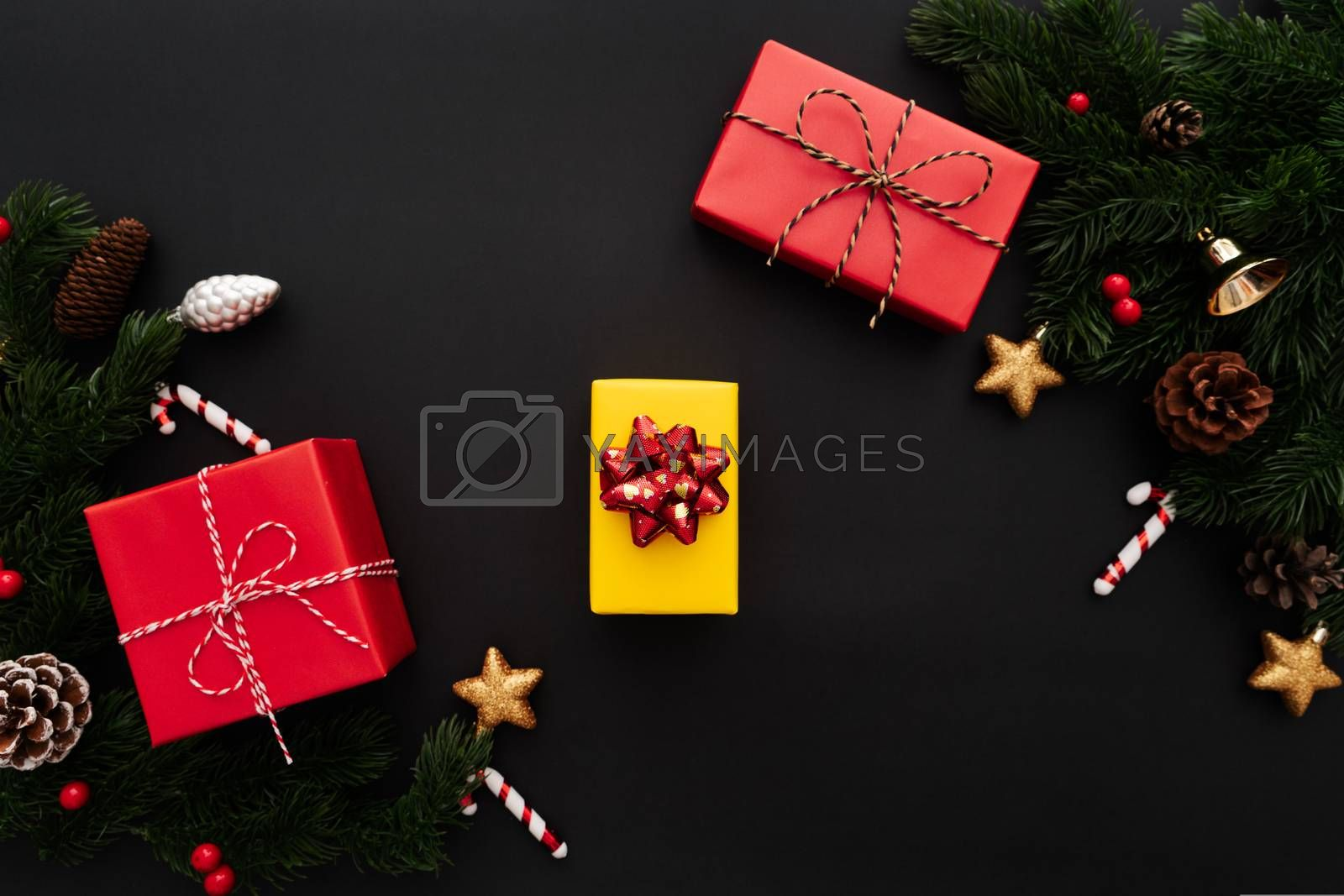 Christmas gift box and pine tree with xmas decoration on black background