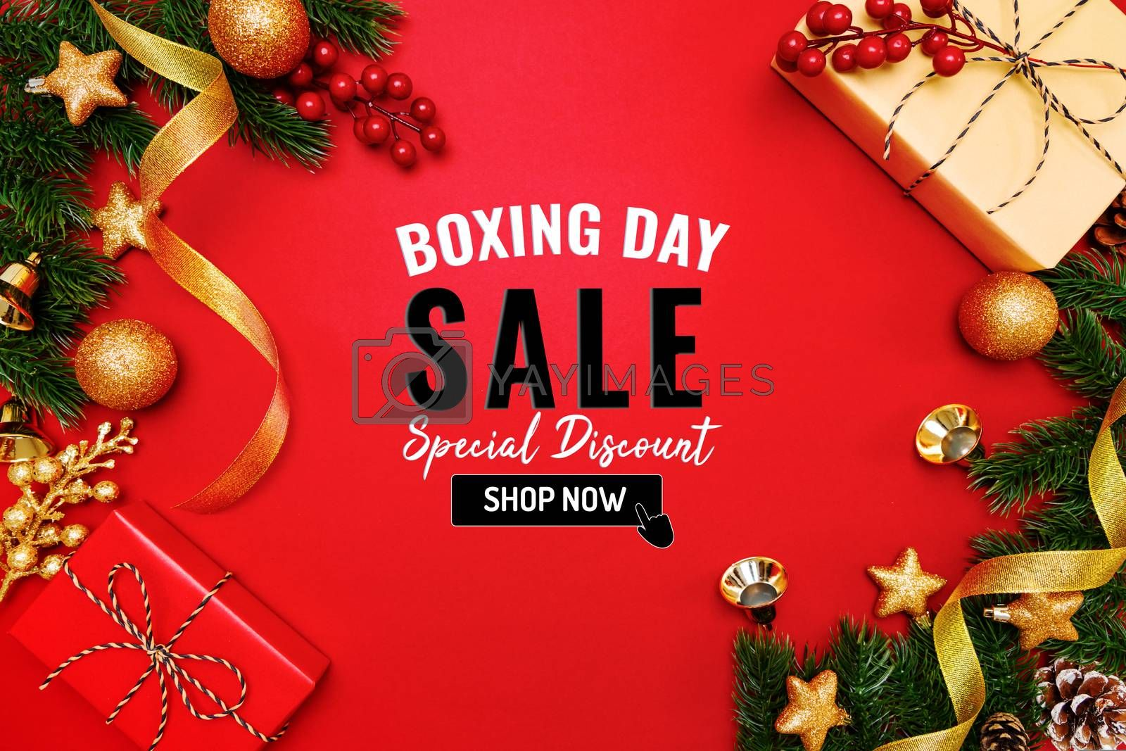 Boxing day sale with Christmas present and xmas decoration on red background
