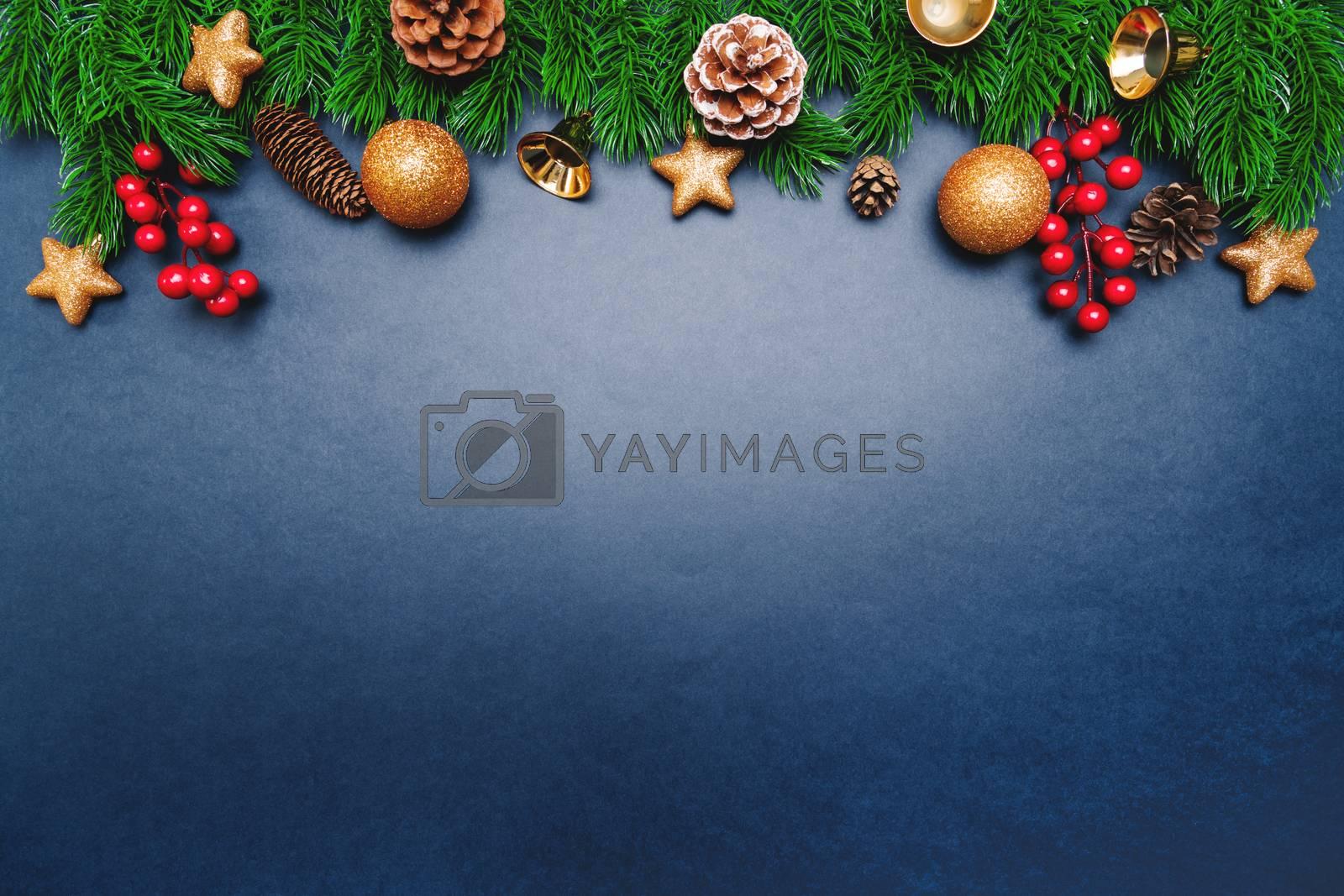 Christmas pine tree with xmas decoration on blue background