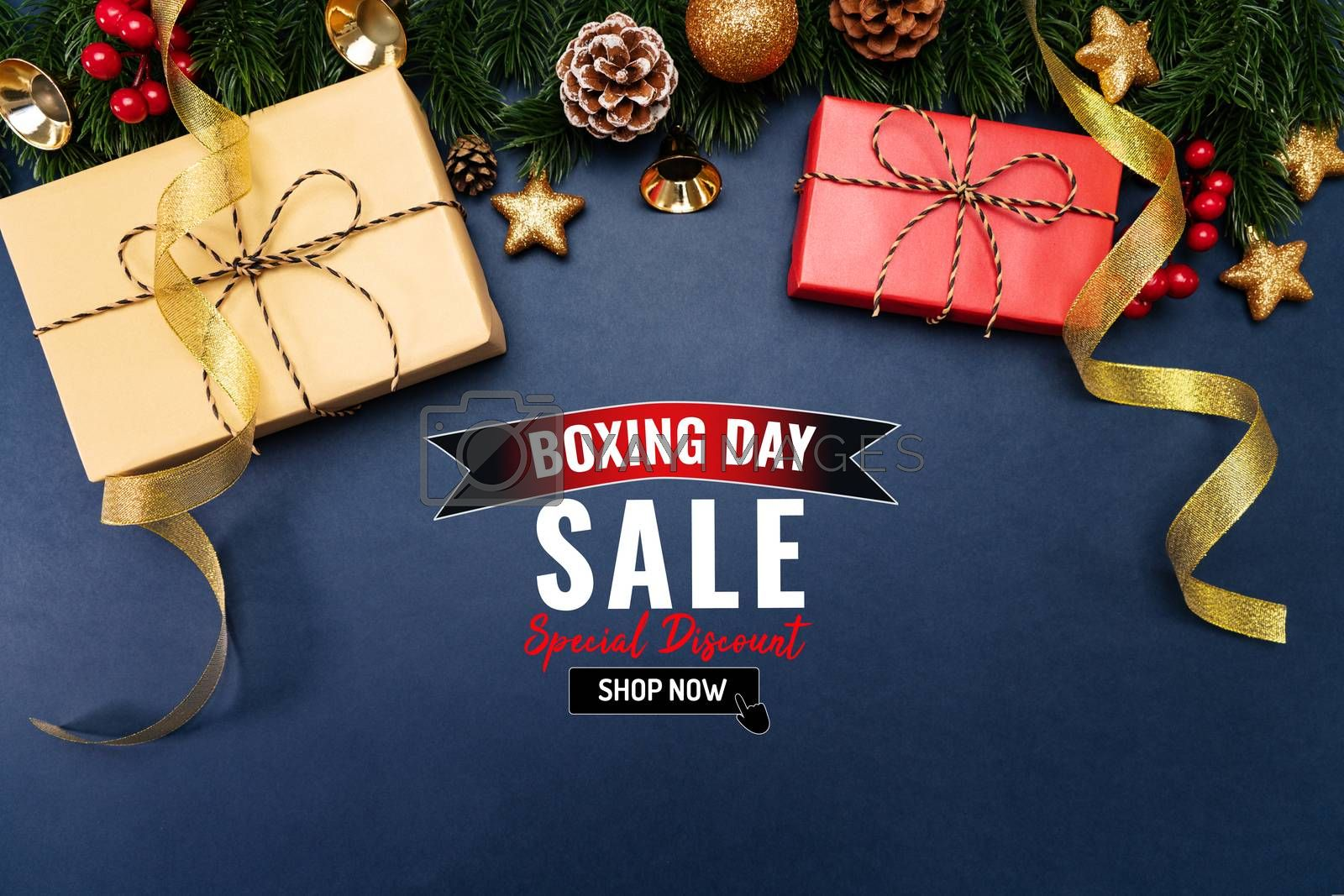 Boxing day sale with Christmas present and xmas decoration on blue background