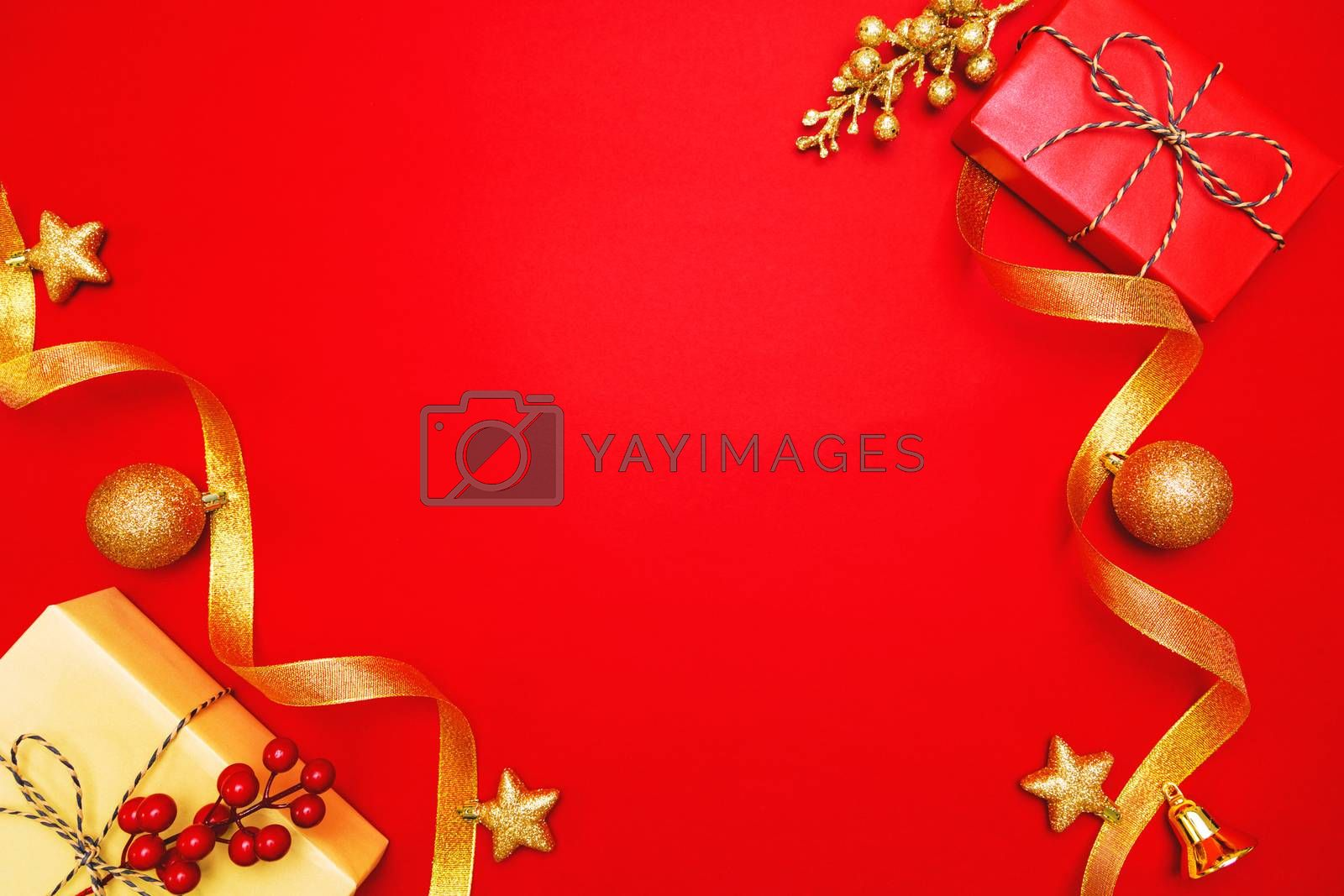 Christmas present and xmas decoration on Red background