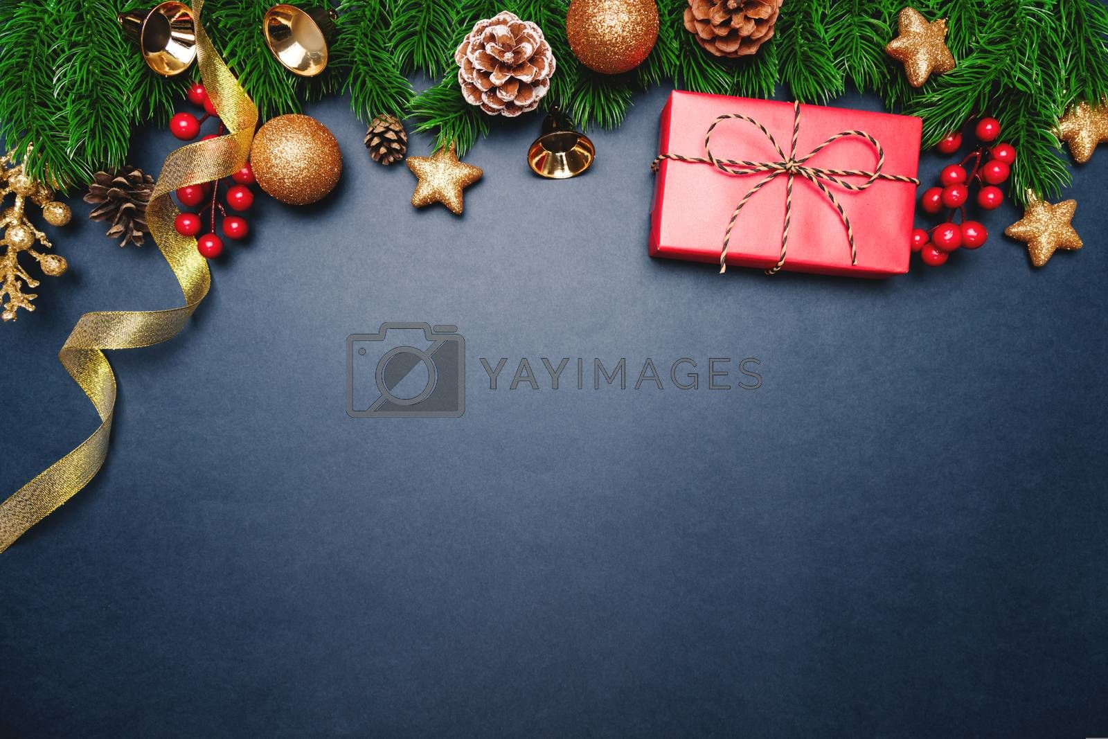 Christmas present and pine tree with xmas decoration on blue background