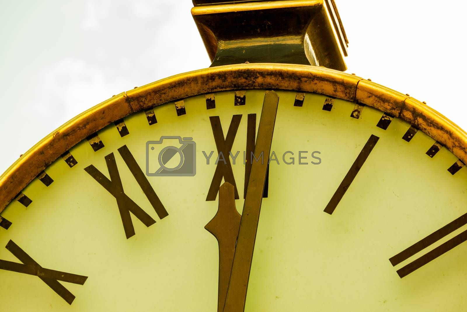 Close up of a retro clock and time is 12 o'clock. Concept of time.