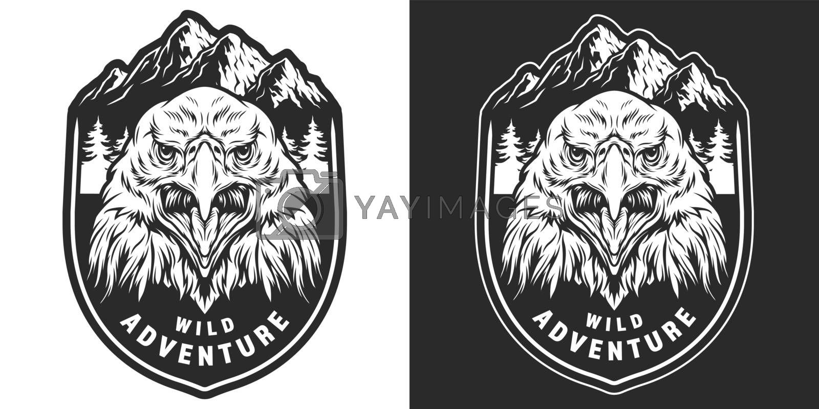 Vintage wild animal monochrome badge with aggressive eagle head on mountains and forest landscape isolated vector illustration