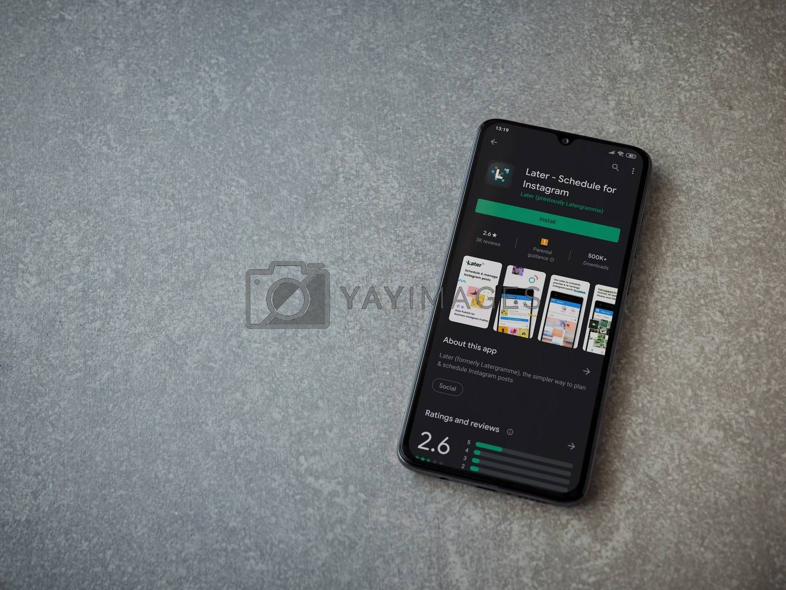 Lod, Israel - July 8, 2020: Later app play store page on the display of a black mobile smartphone on ceramic stone background. Top view flat lay with copy space.