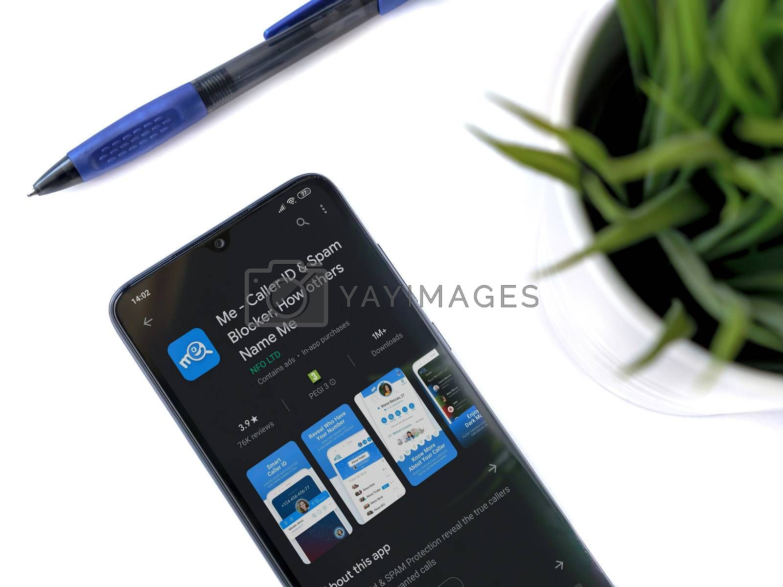 Lod, Israel - July 8, 2020: Modern minimalist office workspace with black mobile smartphone with LiveU app play store page on white background. Top view flat lay with copy space.