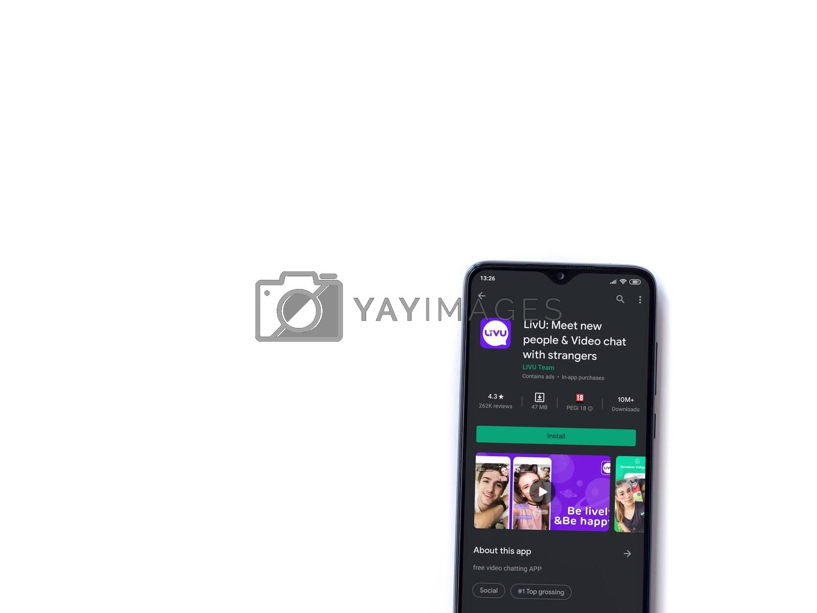 Lod, Israel - July 8, 2020: LiveU app play store page on the display of a black mobile smartphone isolated on white background. Top view flat lay with copy space.
