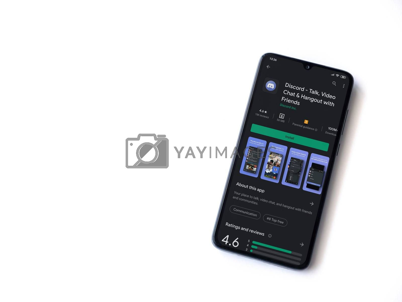 Lod, Israel - July 8, 2020: Discord app play store page on the display of a black mobile smartphone isolated on white background. Top view flat lay with copy space.