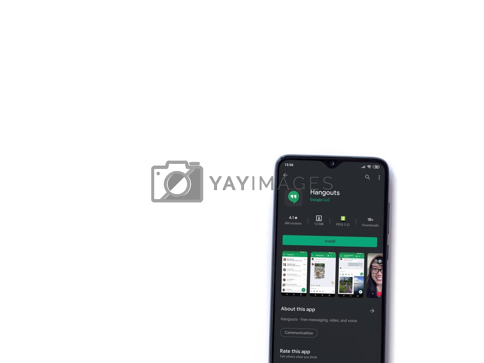 Lod, Israel - July 8, 2020: Hanghouts app play store page on the display of a black mobile smartphone isolated on white background. Top view flat lay with copy space.