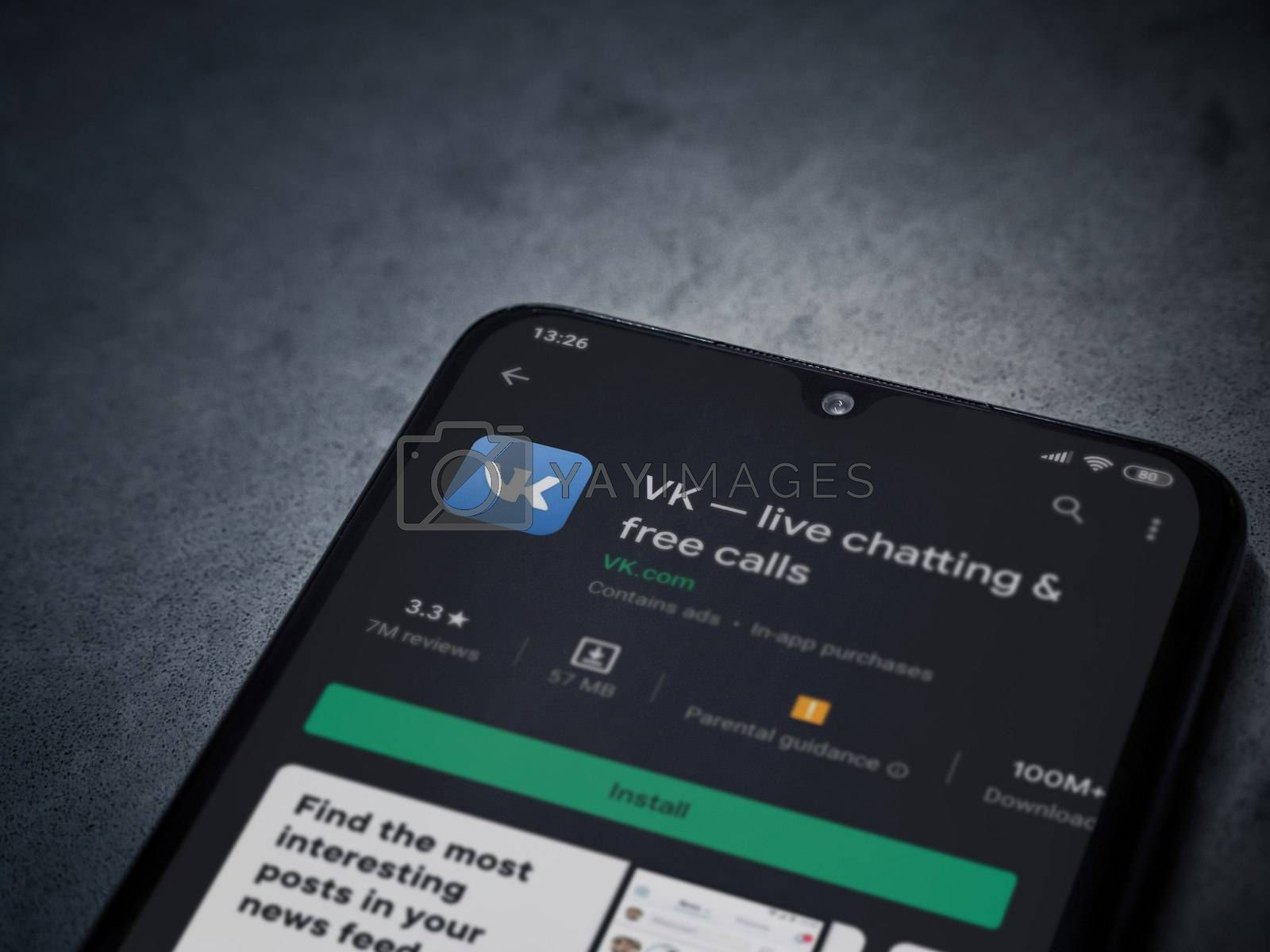 Lod, Israel - July 8, 2020: VK app play store page on the display of a black mobile smartphone on dark marble stone background. Top view flat lay with copy space.