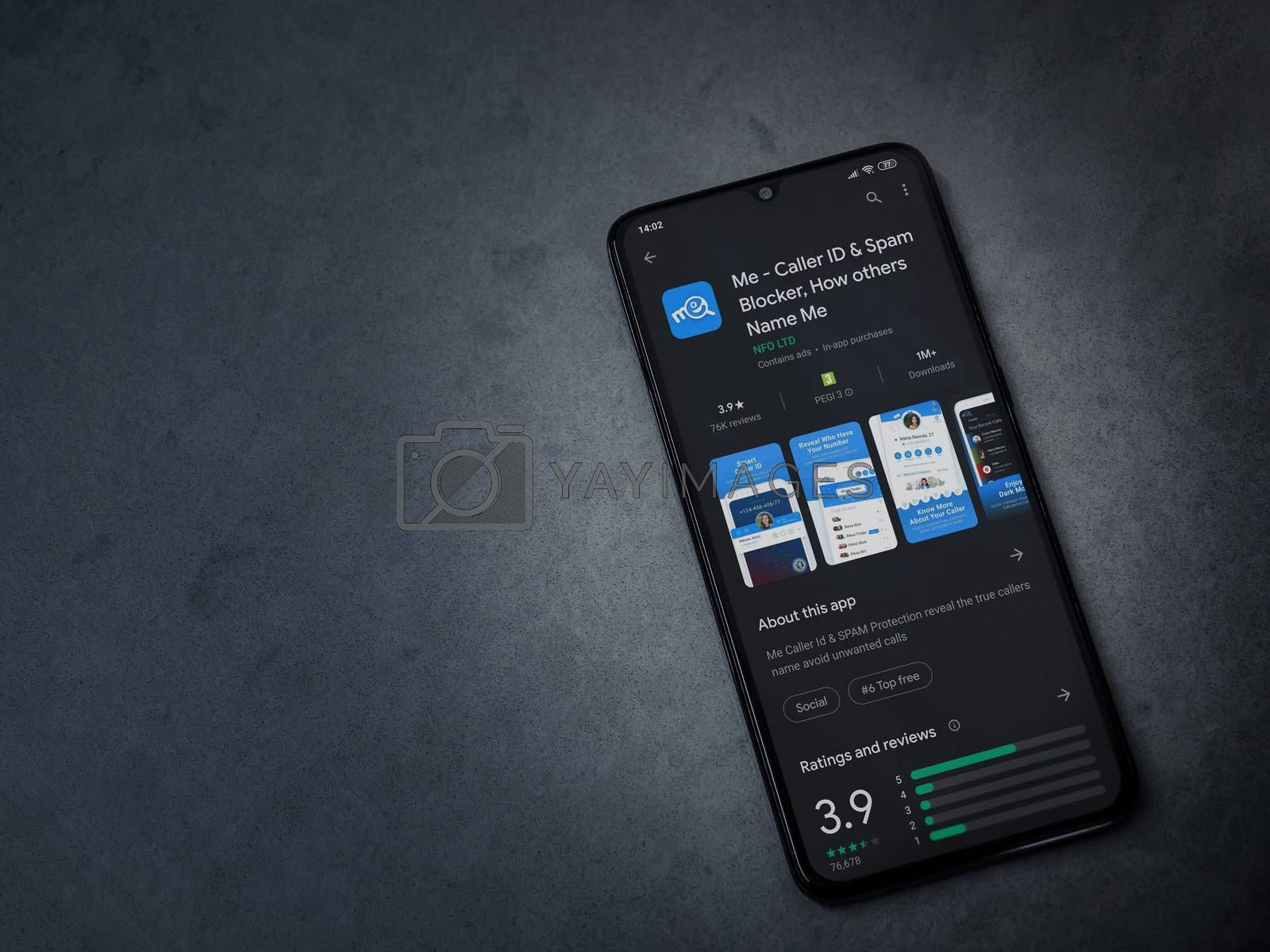 Lod, Israel - July 8, 2020: Me app play store page on the display of a black mobile smartphone on dark marble stone background. Top view flat lay with copy space.