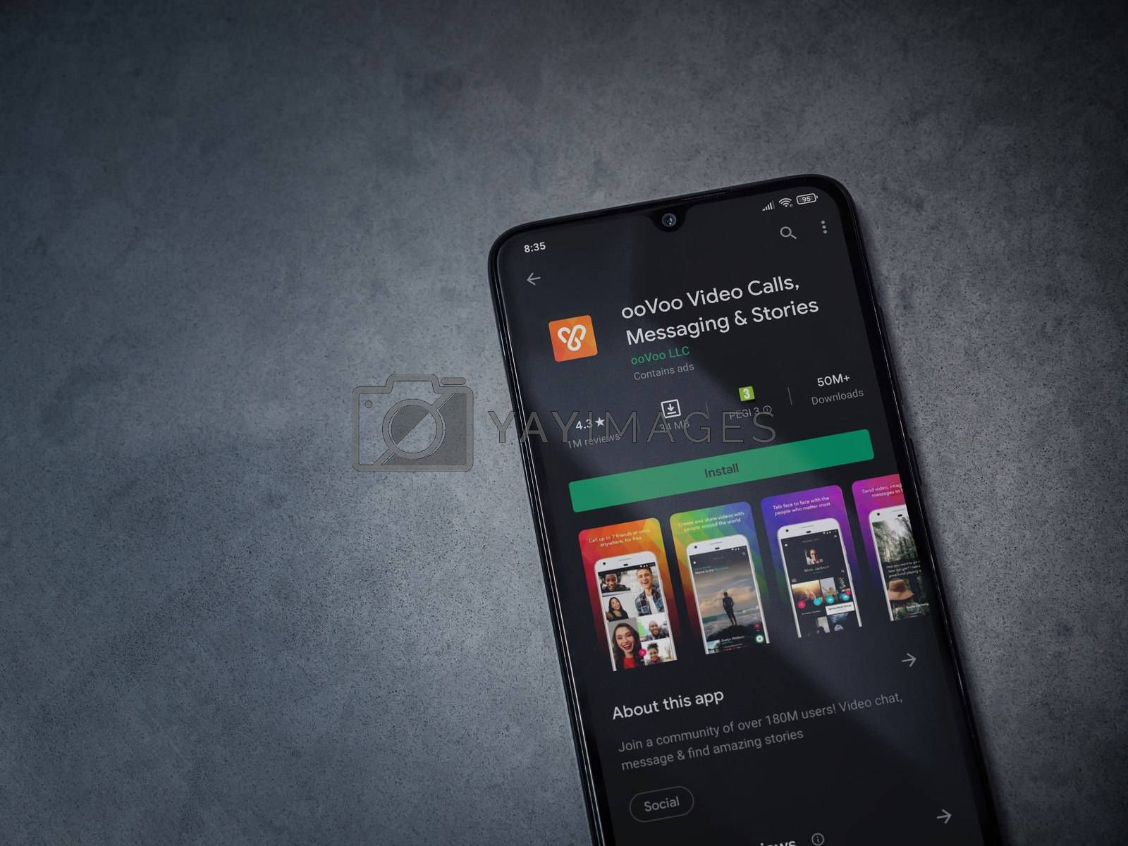 Lod, Israel - July 8, 2020: ooVoo app play store page on the display of a black mobile smartphone on dark marble stone background. Top view flat lay with copy space.