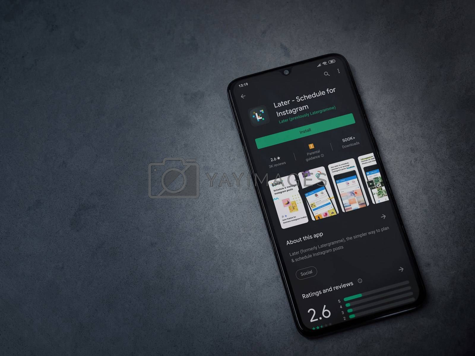 Lod, Israel - July 8, 2020: Later app play store page on the display of a black mobile smartphone on dark marble stone background. Top view flat lay with copy space.