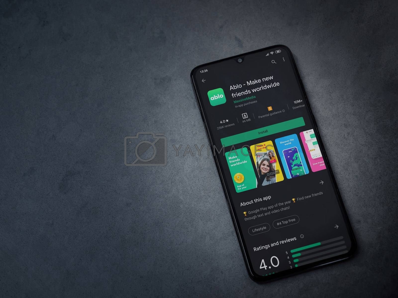 Lod, Israel - July 8, 2020: Ablo app play store page on the display of a black mobile smartphone on dark marble stone background. Top view flat lay with copy space.