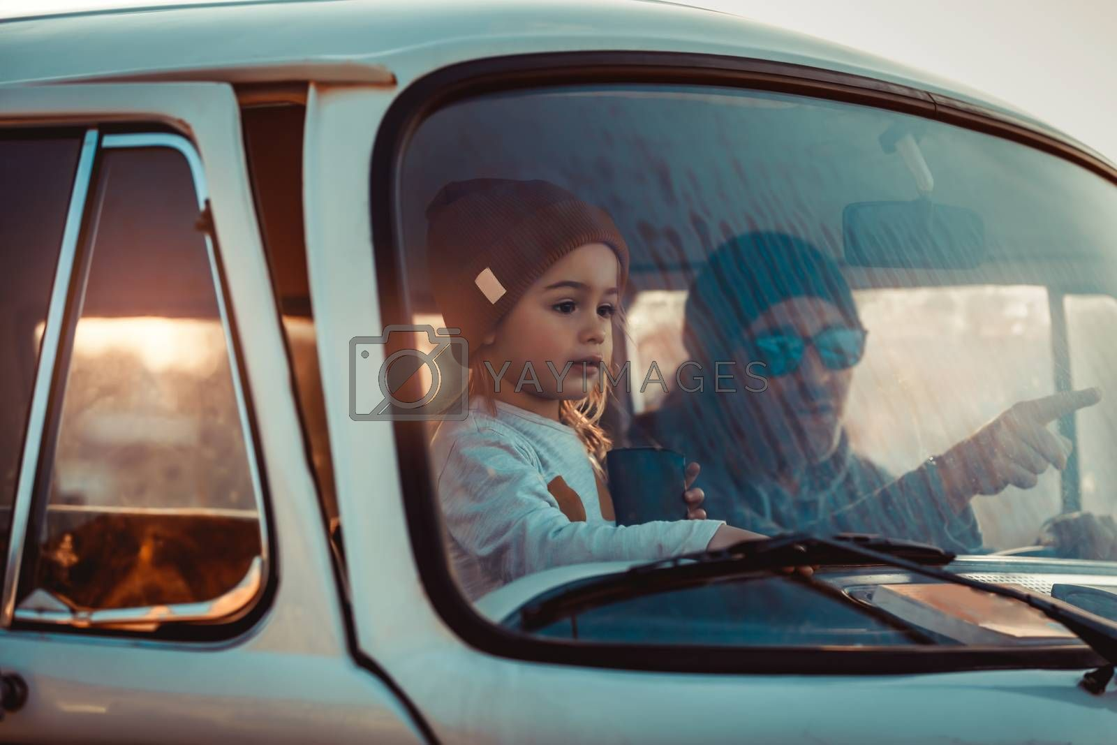 Father with his Little Baby Boy in the Car. Enjoying Road Trip Adventures. Active People. With Pleasure Spending Time Together. Happy Family Life.