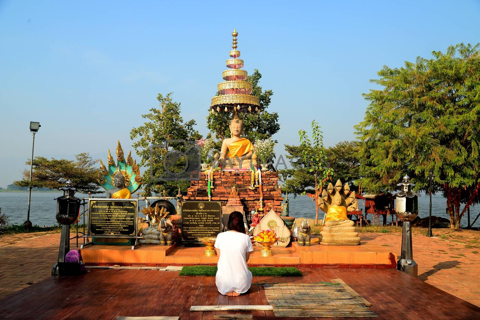 Phayao, Thailand – 21 December, 2019 : Wat Tilok Aram : Year-Old Underwater Temple of Thailand, Today a floating platform with the statue of a Buddha sits directly above the site of the sunken temple.