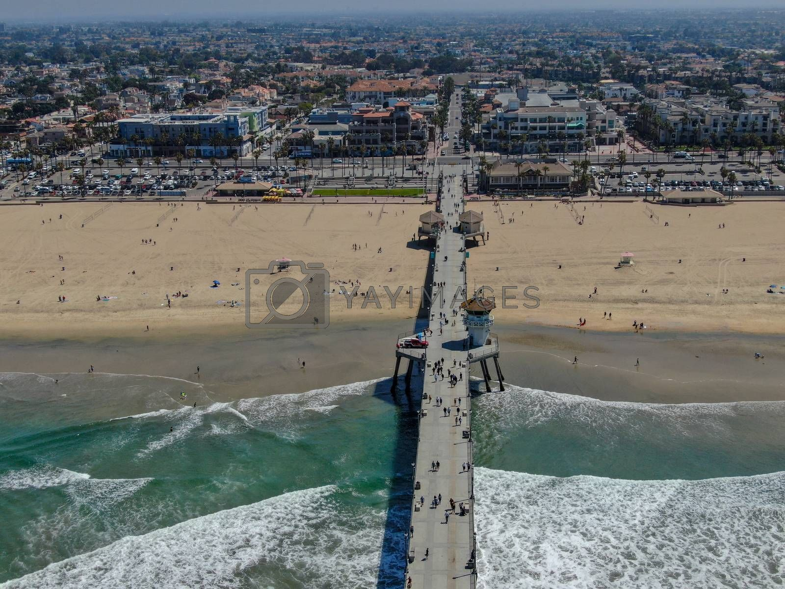 Aerial view of Huntington Pier, beach and coastline during sunny summer day, Southeast of Los Angeles. California. destination for surfer and tourist.