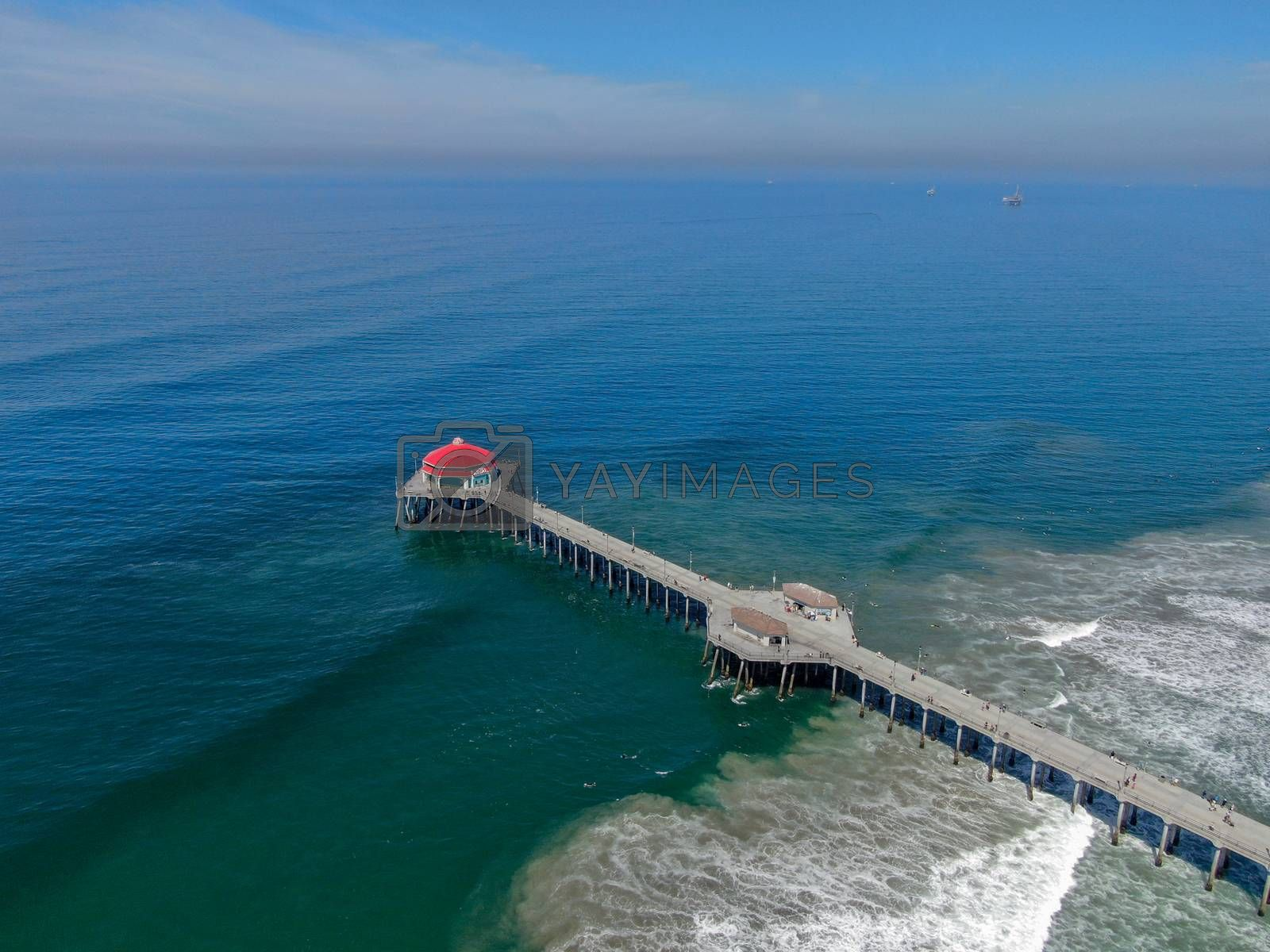 Aerial view of Huntington Pier, beach and coastline during sunny summer day by Bonandbon