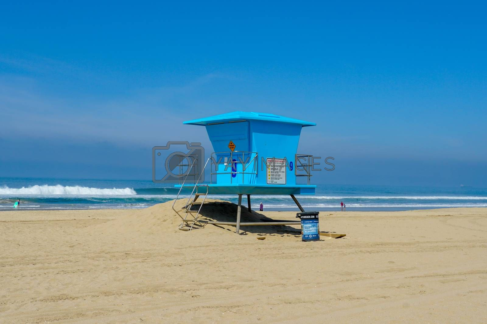 Lifeguard tower on the Huntington Beach during sunny day. by Bonandbon