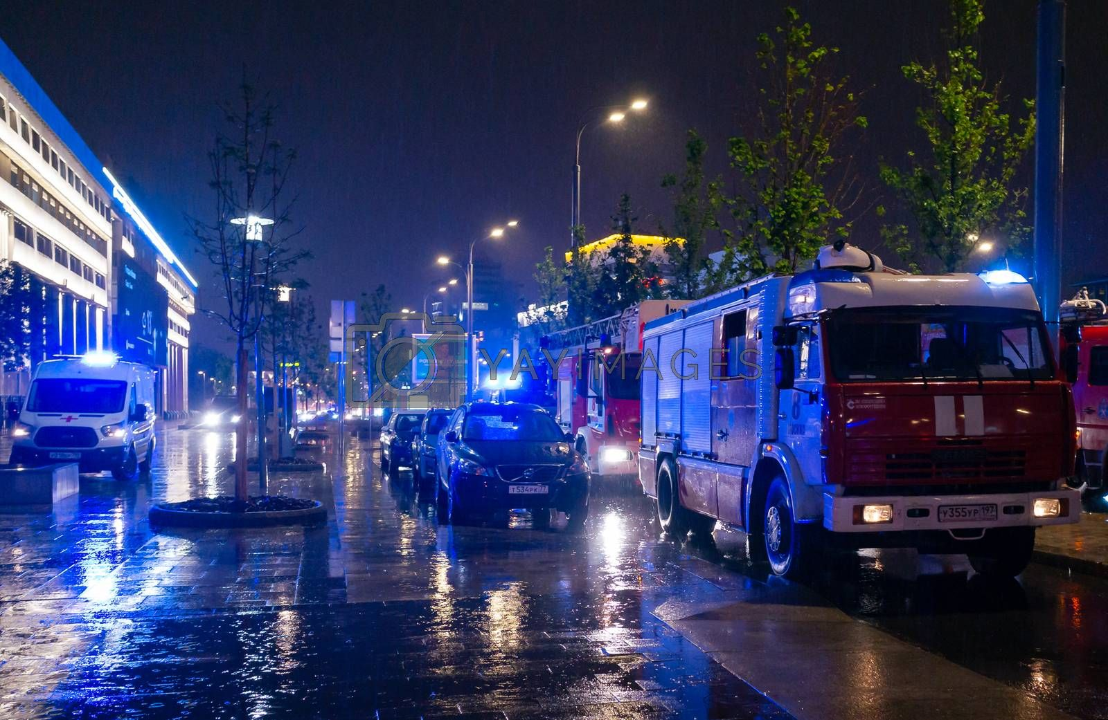 May 15, 2019, Moscow, Russia. Fire engines in the courtyard of the apartment building where the fire occurred, at night during the rain.