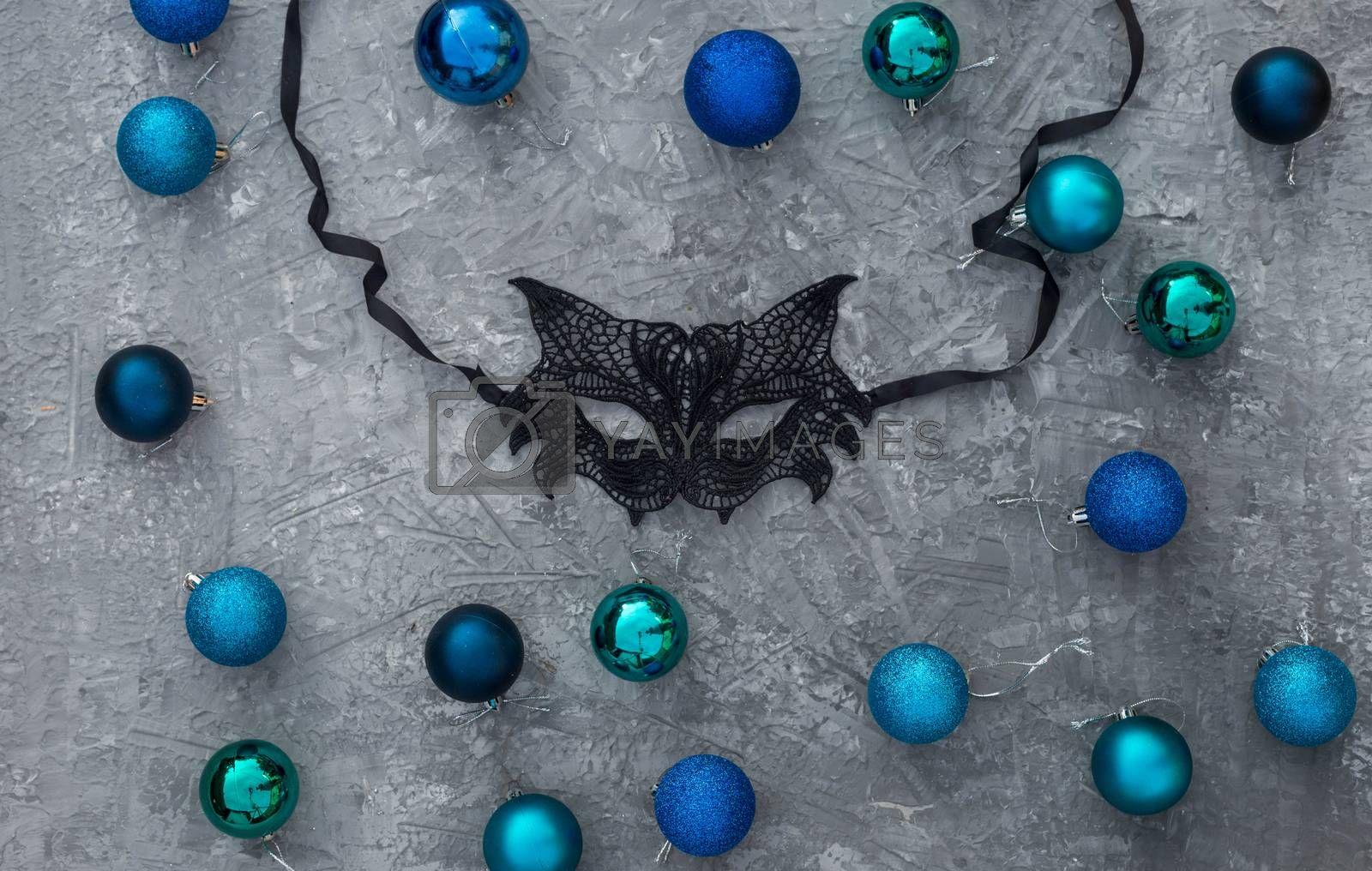 Christmas background with knitted numbers 2021 masquerade lace mask.