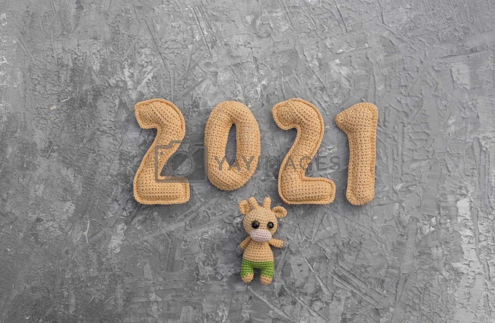 New year background with knitted toy bull symbol of chinese new year 2021