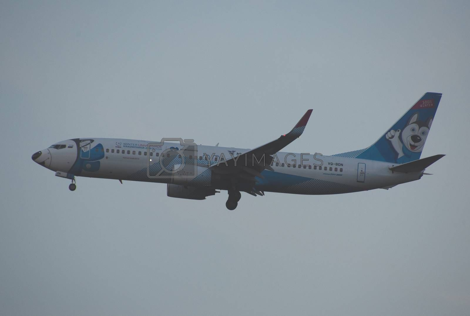 8 JULY 2018 Russia, Moscow. The aircraft Boeing 737 NordStar Airlines painted in Winter Universiade Krasnoyarsk 2019 special colours is landing at the Domodedovo airport.