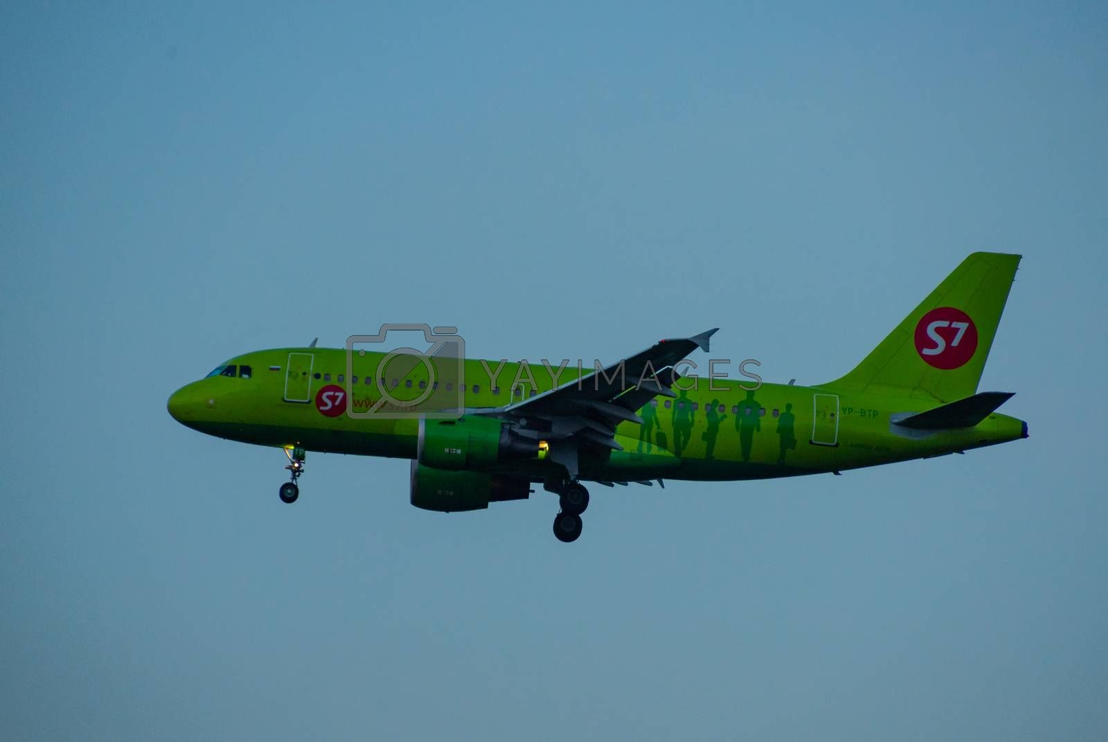 8 JULY 2018 Russia, Moscow. The aircraft Airbus A319 S7 Airlines is landing at the Domodedovo airport.